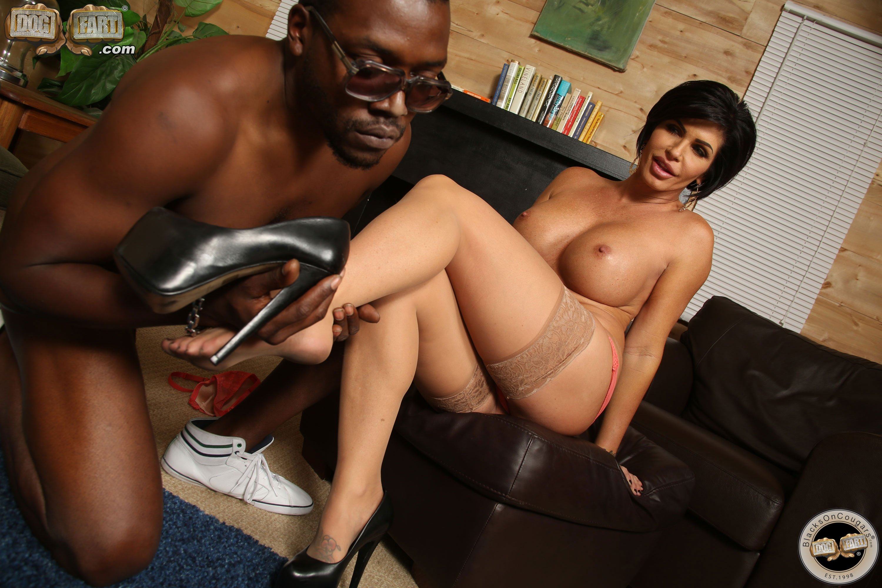 Sexy dark haired milf meets her black friend for erotic interracial sex